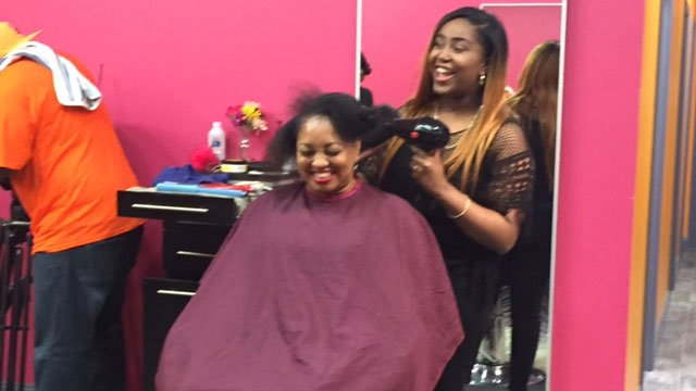 Stefanie Hughes gets her hair done at Colour Me Badd Salon in Mableton. The salon hosted a special Mother's Day event for mothers who have lost children. Source: WGCL