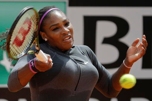 (AP Photo/Andrew Medichini). Serena Williams of the US returns the ball to Christina McHale of the US during their match at the Italian Open tennis tournament, in Rome, Thursday, May 12, 2016.