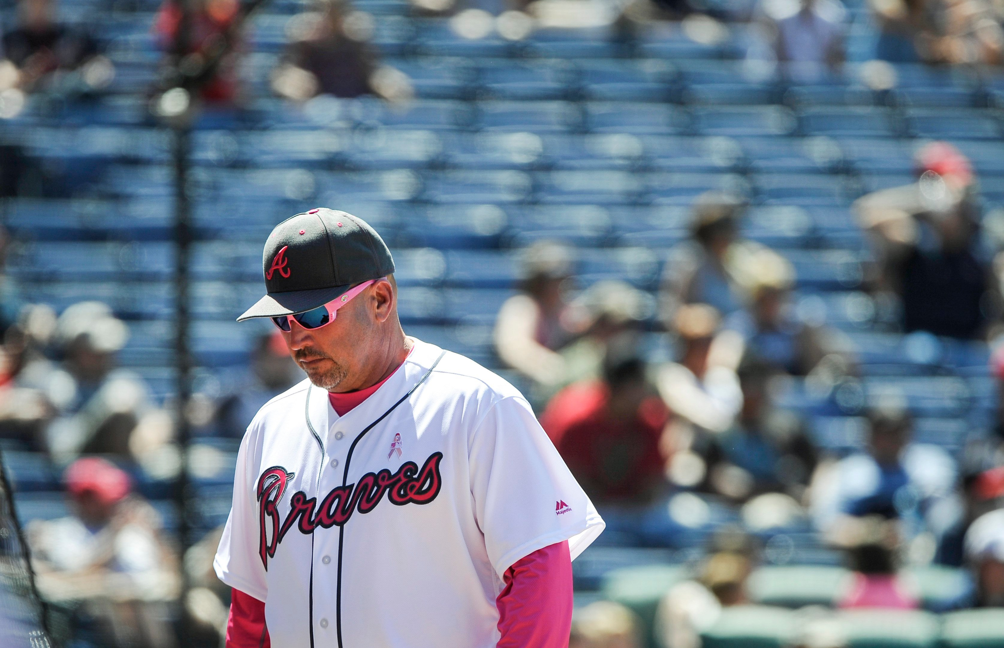 Atlanta Braves manager Fredi Gonzalez comes off the field with half-empty stands behind him after discussing a call with an umpire during the eighth inning of a baseball game against the Diamondbacks, Sunday, May 8, 2016, in Atlanta. (AP PhotoJohn Amis)