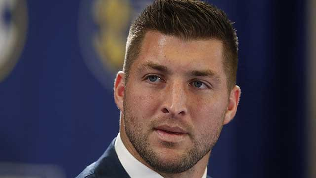 Tim Tebow shows solid power, shaky skills in MLB workout