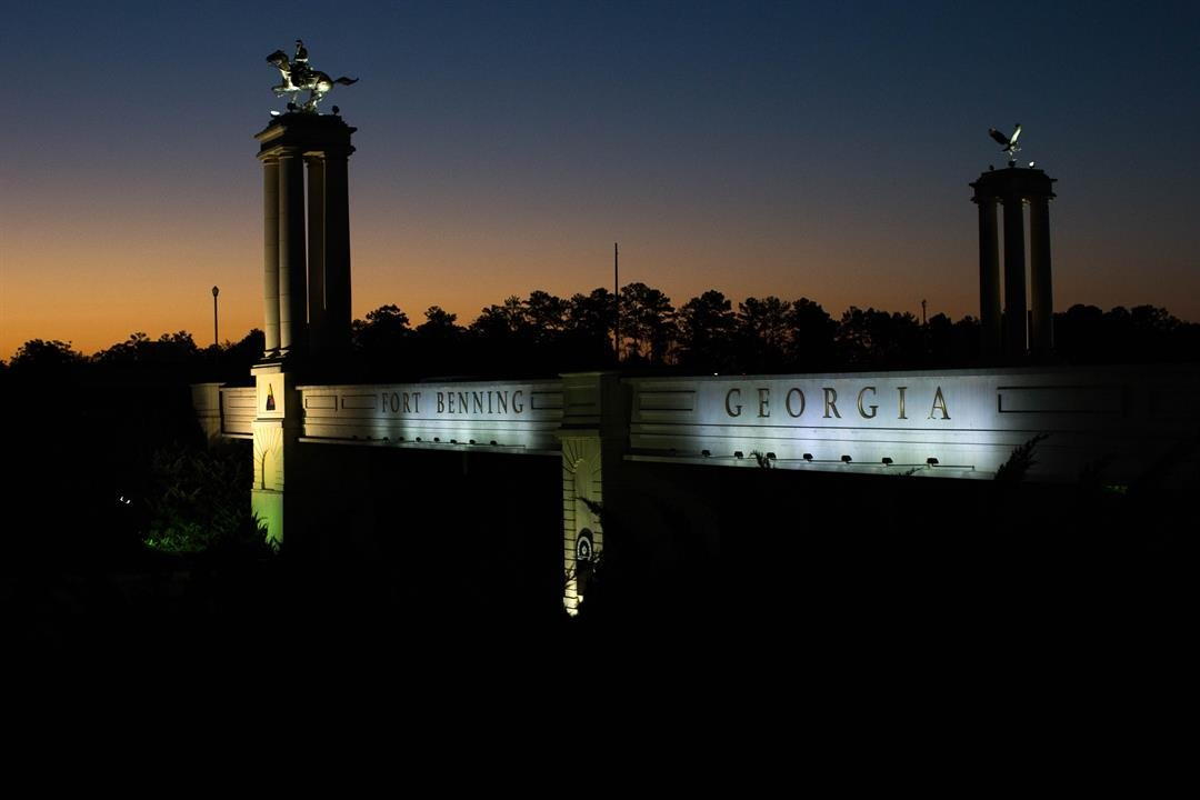 A bridge marks the entrance to the U.S. Army's Fort Benning as the sun rises, Friday, Oct. 16, 2015, in Columbus, Ga.  (AP Photo/Branden Camp)