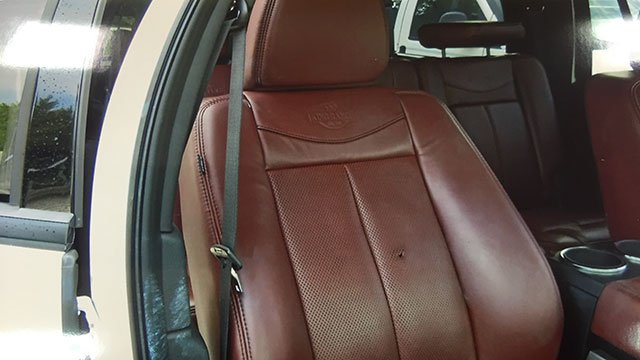Photograph shows seat and bullet hole where Diane McIver was sitting when she died. (SOURCE: Defense Attorney for Tex McIver)