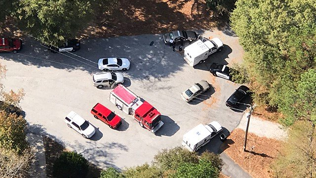 Authorities investigate an apparent officer-involved shooting in Walton County. (SOURCE: WGCL)