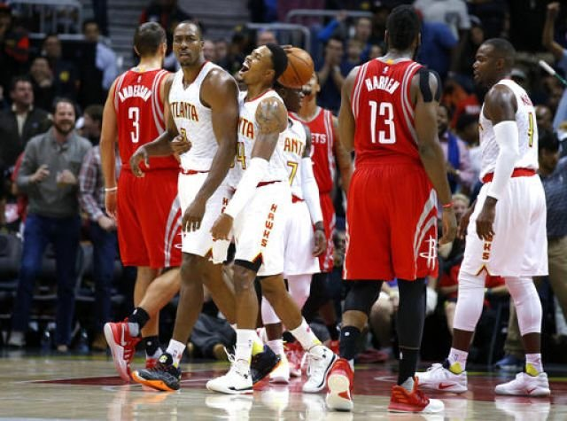 Atlanta Hawks center Dwight Howard (8) reacts after being called for a foul during the first half of an NBA basketball game against the Houston Rockets on Saturday, Nov. 5, 2016, in Atlanta. (AP Photo/Todd Kirkland)