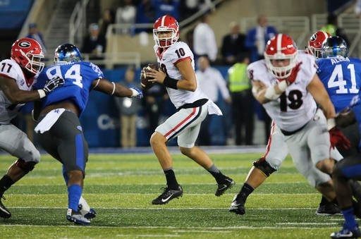 Georgia quarterback Jacob Eason looks for a receiver in the first half of an NCAA college football game against Kentucky Saturday, Nov. 5, 2016, in Lexington, Ky. Georgia won 27-24. (AP Photo/David Stephenson)