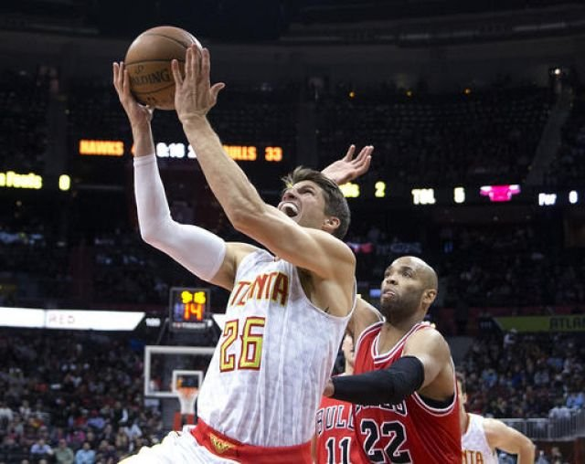 Atlanta Hawks guard Kyle Korver (26) goes up for a shot against Chicago Bulls forward Taj Gibson (22) during the first half of an NBA basketball game Wednesday, Nov. 9, 2016, in Atlanta. (AP Photo/John Bazemore)