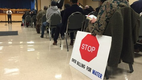 Citizens in DeKalb County look on as interim-CEO Lee May addresses them during a town hall meeting about the county's water billing issues. (SOURCE:WGCL)