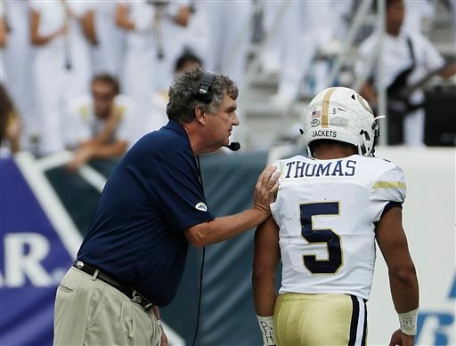 Georgia Tech head coach Paul Johnson, left, talks with quarterback Justin Thomas during an NCAA college football game against Georgia Southern in Atlanta, Saturday, Oct. 15, 2016. (AP Photo/David Goldman)