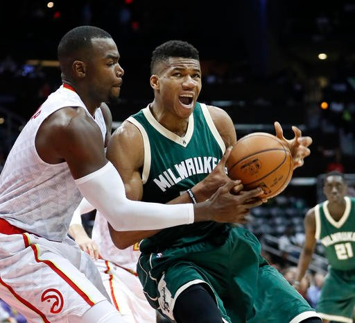 Milwaukee Bucks forward Giannis Antetokounmpo (34) works against Atlanta Hawks forward Paul Millsap (4) in the second half of an NBA basketball game Wednesday, Nov. 16, 2016, in Atlanta. Atlanta won 107-100. (AP Photo/John Bazemore)