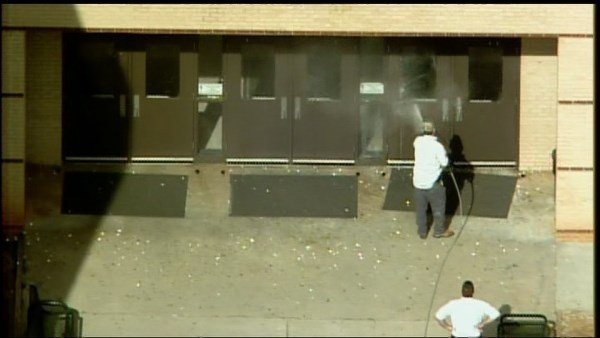 Maintenance cleaning up the scene after local high school was vandalized. (Source: WGCL)