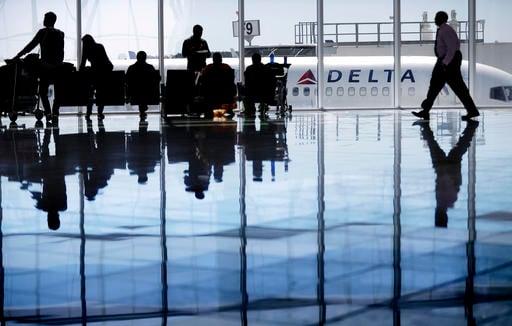 A Delta Air Lines jet sits at a gate at Hartsfield-Jackson Atlanta International Airport, in Atlanta. (SOURCE: AP Images)