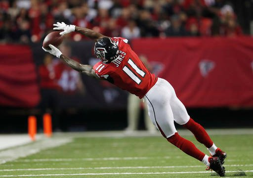 Atlanta Falcons wide receiver Julio Jones (11) makes the catch against the Kansas City Chiefs during the second half of an NFL football game, Sunday, Dec. 4, 2016, in Atlanta. (AP Photo/John Bazemore)