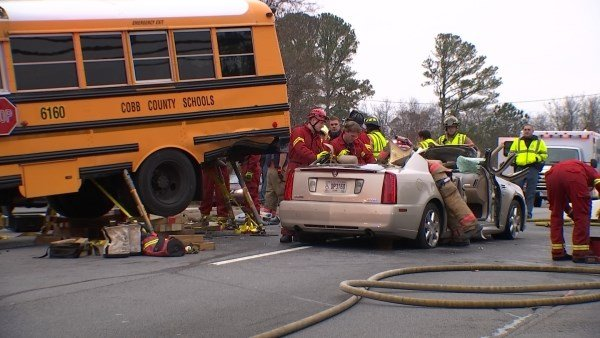 Cobb County School Bus Car Collide With Several Students
