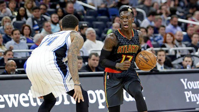 Atlanta Hawks' Dennis Schroder (17) looks for a way past Orlando Magic's D.J. Augustin (14) during the second half of an NBA basketball game, Wednesday, Jan. 4, 2017, in Orlando, Fla. Atlanta won 111-92. (AP Photo/John Raoux)