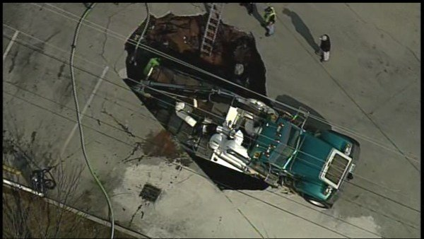 Sinkhole at vehicle wash swallows truck weighing 55000 pounds
