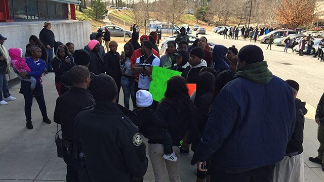 A group of people gathered Friday at the scene where a man was shot to death by a police officer in Atlanta. (SOURCE: WGCL)