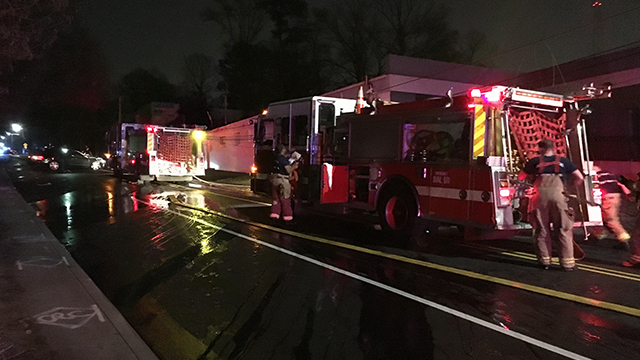 Police said a vehicle struck a power pole on Northside Dr. before that pole fell onto a nearby business causing a small fire. (SOURCE: WGCL)