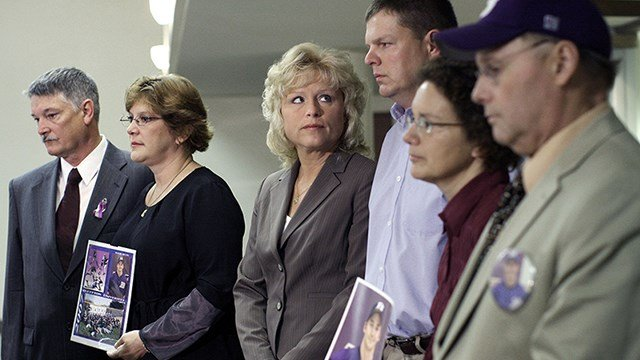 Parents of members of Ohio's Bluffton University baseball team crash victims take part in a news conference, Tuesday, July 8, 2008, before a meeting of the National Transportation Safety Board. From left are, Barry and Lynn Mesley, parents of James Hausma