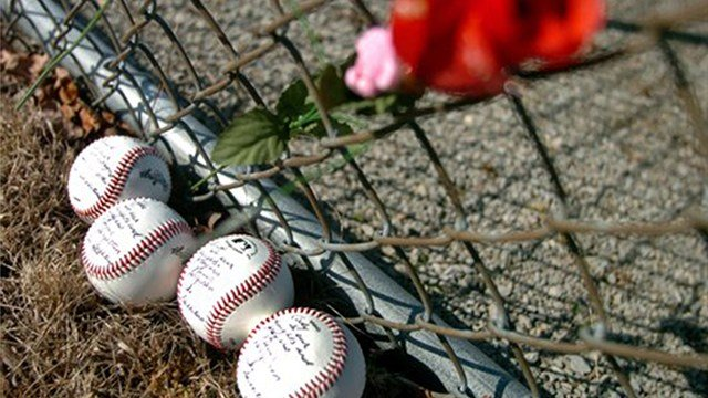 Baseballs with the name of each of the Bluffton University players who died in a bus crash lie on the ground Monday, March 5, 2007, near the team's diamond at teh school in Bluffton, Ohio A message to each of the players was written on the baseballs. (AP