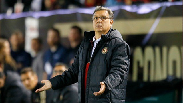 Atlanta United FC head coach Gerardo Martino watches play in the second half of an MLS soccer game with the New York Red Bulls on Sunday, March 5, 2017, in Atlanta. The Red Bulls won the game 2-1. (AP Photo/Todd Kirkland)