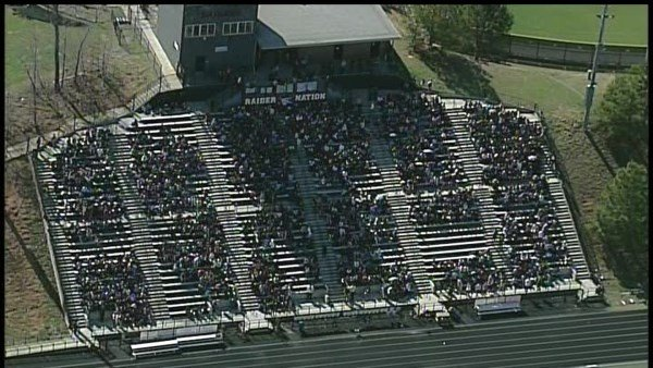 Students at Alpharetta HS were evacuated to the football field Thursday, after a threat was emailed to the school. (SOURCE: WGCL)