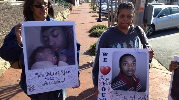 Ariston Waiters supports attend a rally in 2012 following his shooting death. (SOURCE: WGCL)