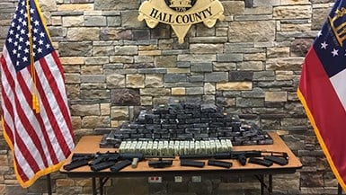 Authorities in Hall County said they found guns and drugs at a home there. (SOURCE: Hall County Sheriff's Office)