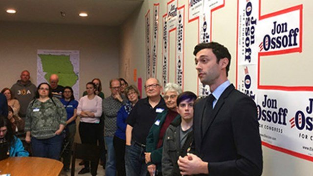 Georgia Democratic congressional candidate Jon Ossoff speaks to volunteers in his Cobb County campaign office. Ossoff is trying for an upset in a Republican-leaning district outside Atlanta. (AP Photo/Bill Barrow)