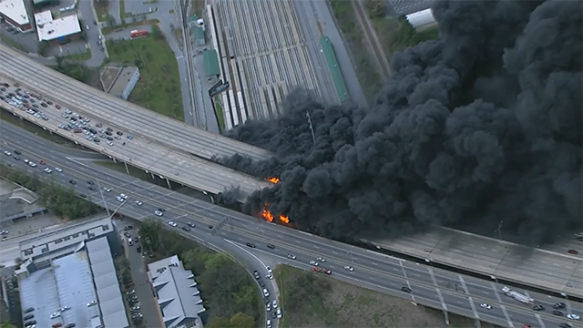 A massive fire burned under I-285, causing a portion of the bridge to collapse Thursday afternoon. (SOURCE: WGCL)