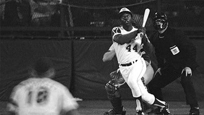 In this April 8, 1974 file photo, Atlanta Braves' Hank Aaron eyes the flight of the ball after hitting his 715th career homer in a game against the Los Angeles Dodgers in Atlanta. The 40th anniversary of Hank Aaron's 715th home run finds the Hall of Famer