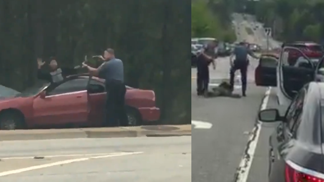 Two Gwinnett County, GA officers were fired after video shows them punching and kicking a man who has his hands up and was handcuffed during an arrest. (SOURCE: Social Media)