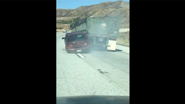 Vehicle dragged for miles by big rig truck