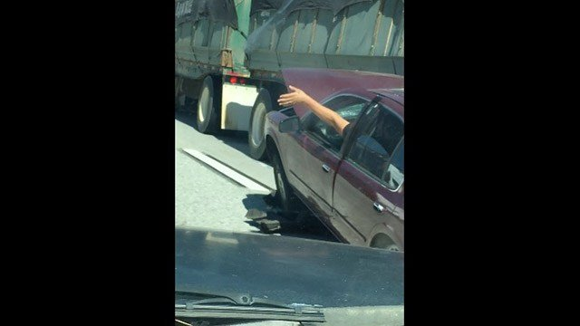 Auto  dragged for miles by big rig truck