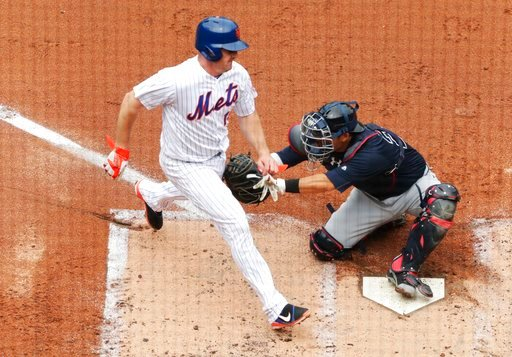 Atlanta Braves catcher Kurt Suzuki tags out New York Mets' Jay Bruce at home plate during the second inning of a baseball game Thursday, April 27, 2017, in New York. (AP Photo/Frank Franklin II)
