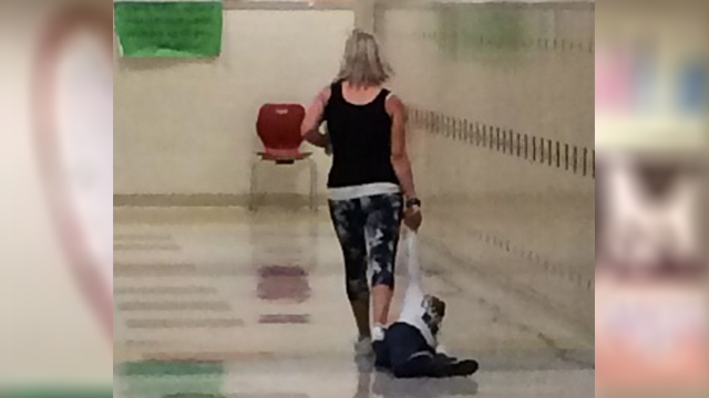 An Ohio Head Start teacher was fired after a colleague snapped this photo of the woman dragging a young student down a hallway