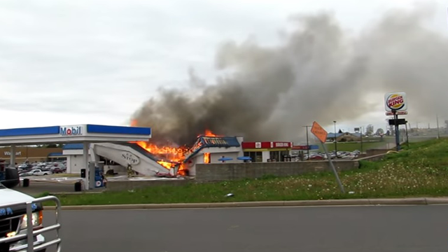 Dramatic video shows firefighter trapped underneath burning gas station