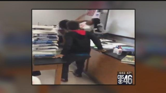 Fight between teacher, staff member caught on video