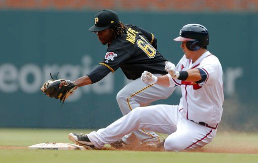 Atlanta Braves' Kurt Suzuki (24) is safe at second base with a double as Pittsburgh Pirates second baseman Gift Ngoepe (61) handles the late throw in the ninth inning of a baseball game Thursday, May 25, 2017, in Atlanta. AP Photo/John Bazemore
