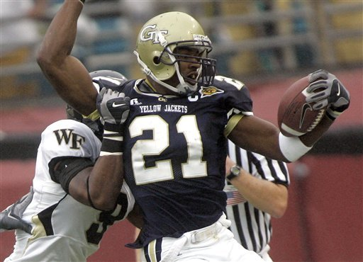 Georgia Tech receiver Calvin Johnson, right, is tackled in the first quarter by Wake Forest defender Chip Vaughn during the ACC Championship game, Saturday, Dec. 2, 2006, in Jacksonville, FLa. (AP Photo/Phil Coale)