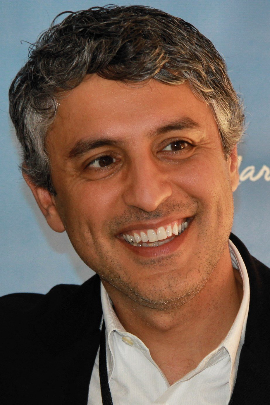 Documentary producer and religious scholar Reza Aslan is the second CNN personality to be booted for making disparaging toward President Donald Trump on social media.