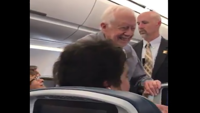 Ex-president Carter Shakes Hands With Everyone on Flight