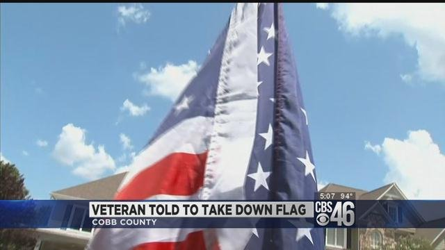 Veteran told to take down flag