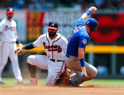 Chicago Cubs' Ian Happ (8) is tagged out by Atlanta Braves second baseman Sean Rodriguez (15) as he tries to steal second base in the fourth inning of a baseball game Wednesday, July 19, 2017, in Atlanta. (AP Photo/John Bazemore)