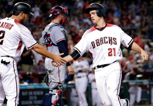 Arizona Diamondbacks' Jeff Mathis (2) greets Zack Greinke (21) after they both scored on a double by teammate A.J. Pollock during the second inning of a baseball game against the Atlanta Braves, Monday, July 24, 2017, in Phoenix. (AP Photo/Matt York)