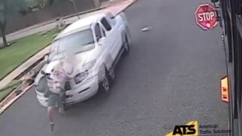 School bus camera captures violator's car striking child in Austin, TX (Child was not badly wounded.)