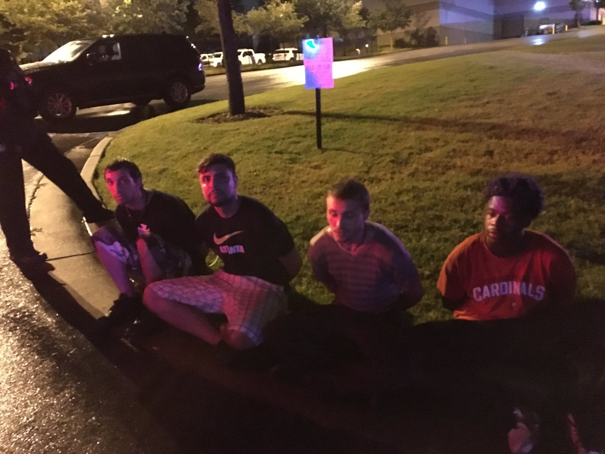 Suspects in handcuffs on a curb. (Source: Clayton County Police Dept.)