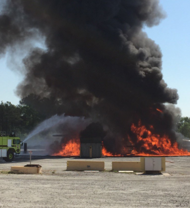 The Atlanta Fire Rescue Department is extinguishing a simulated plane fire, which is necessary to receive annual certification for Airport Rescue firefighters.