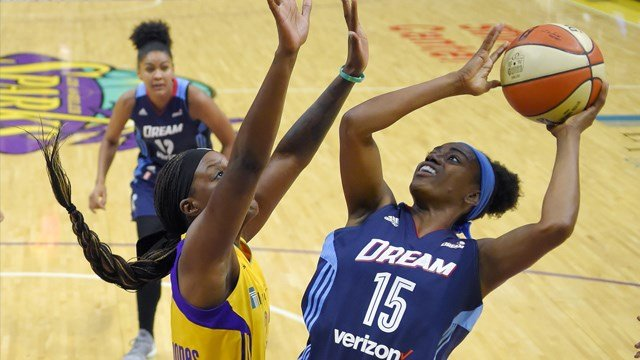 Atlanta Dream guard Tiffany Hayes, right, shoots as Los Angeles Sparks forward Tiffany Jackson-Jones defends during the second half of a WNBA basketball game, Friday, Sept. 1, 2017, in Los Angeles. The Sparks won 81-56. (AP Photo/Mark J. Terrill)