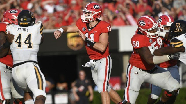 Georgia quarterback Jake Fromm watches a pass as Appalachian State linebacker Anthony Flory (44) applies defense during the first half of an NCAA college football game, Saturday, Sept. 2, 2017, in Athens, Ga. Georgia won 31-10. (AP Photo/John Amis)