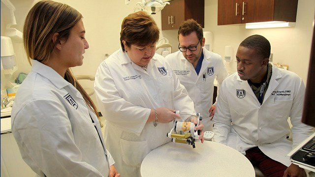 Dr. Carol Lefebvre, second from left, works with residents in The Dental College of Georgia at Augusta University. Source: The Dental College of Georgia at Augusta University